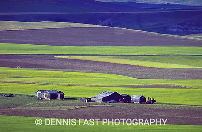 ROLLING PRAIRIE LANDSCAPE.  I love the look of agricultural, rolling prairie landscapes, especially when old buildings are involved. Although this photo is reminiscent of the well-known Palouse area in Washington State, this photo was actually taken on the Canadian prairies.