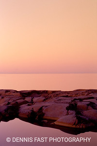 "SUNSET OVER BIRD COVE.  Hudson Bay in a rare moment of stillness reflects the sunset perfectly. People who have seen this print often assume it to be a watercolour, but even photography can be art! I love the tranquility and quiet strength of the rocks which seem almost ""soft"" in the context of the still water sunset."