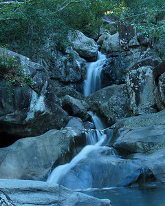 The famous bridge and the waterfalls at the Little Crystal Creek, in the Paluma National Park. Australia.