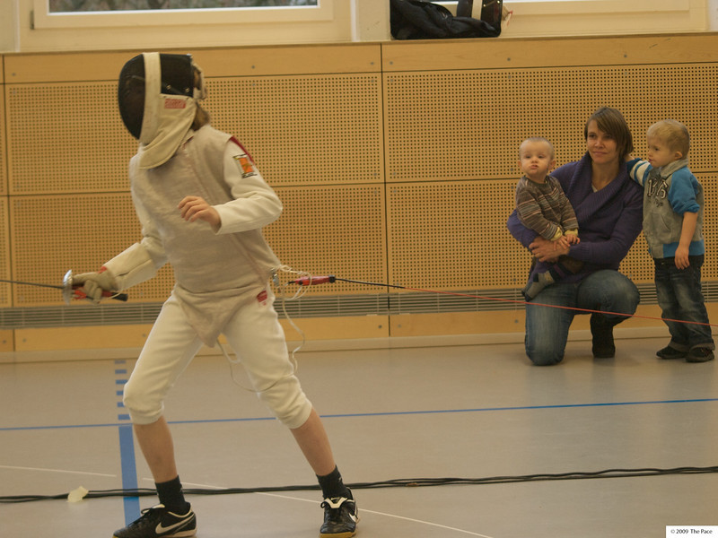 Tuesday 8th December 2009 - Oliver in a fencing competition as Cai luc and mum look on