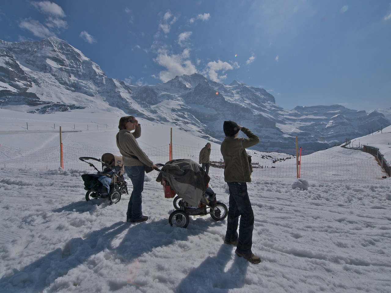 Sunday 5th April 2009 - I am not sure what they are looking at the paraglider is behind them, but later we discuss pushing the prams down to the next station, but decide that the snow is too soft and take the train
