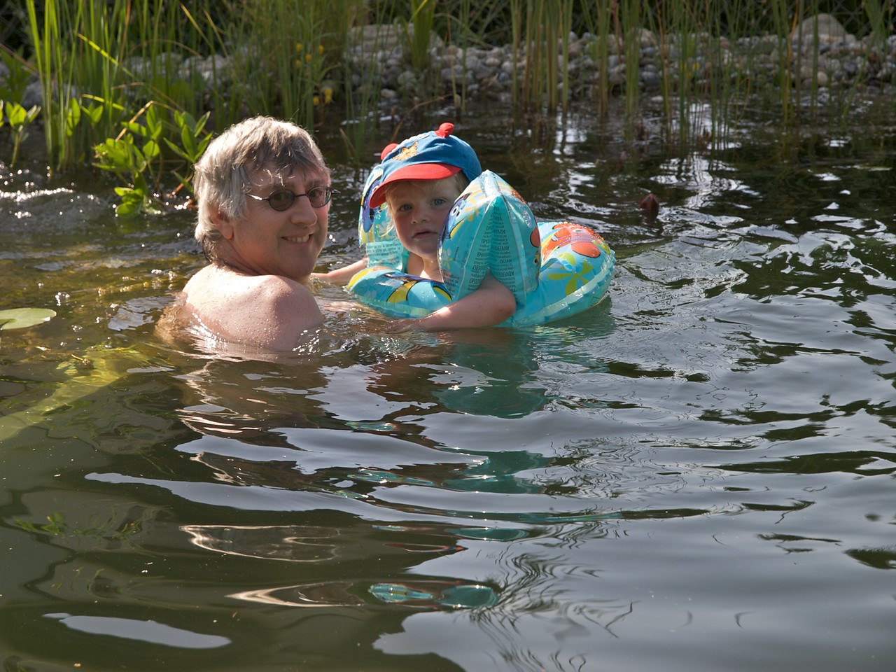 Sunday 20th June 2010 - Although the weather has been cold there have been very warm spells, here is Luc's first time in the pond, He thought it too cold ( the water was 24 degrees) and cried but once he got over the shock we think he actually liked it.
