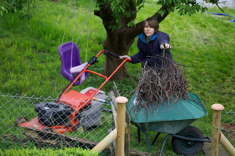 Sunday 16th May 2010  - spring is here, well the grass needs cutting, Kerstin shows off her skills as a woman by multitasking, mowing the lawn and building a nest.