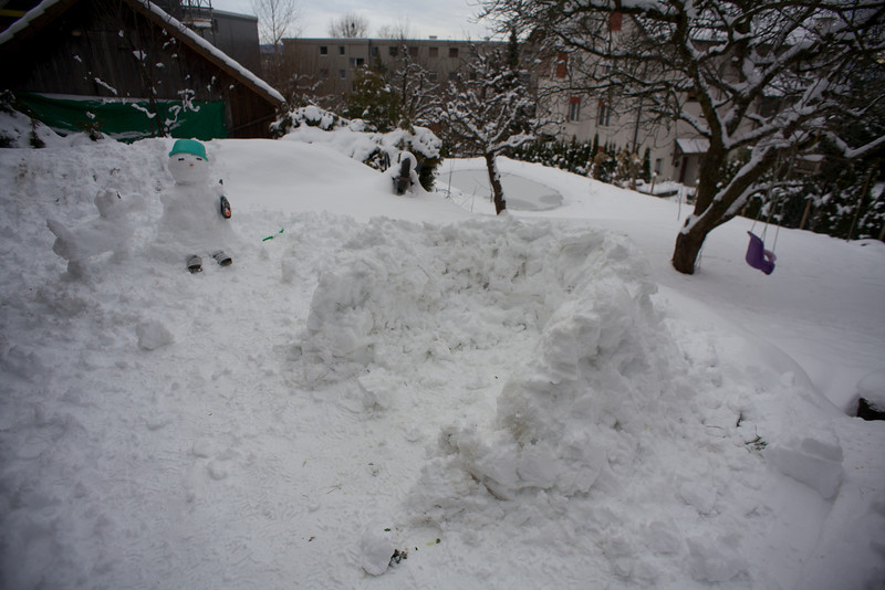 Sunday 19th December 2010 - My attempt at an igloo, in the background you can see our pond though none of us are keen to break the ice and dive in