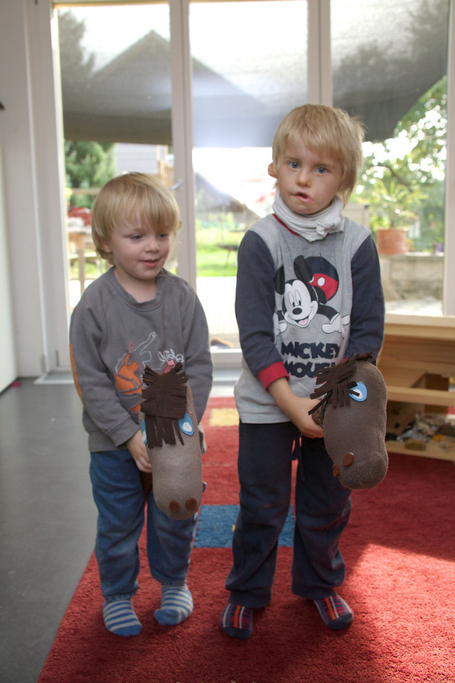 "Tuesday 27th Sept 2011 - Kerstin makes ""Horses"" for the boys.<br /> <br /> I  have been suffering so had a couple of days sick, but after a couple of days sleep I am feeling better now. Kersti made two stick horses on Sunday, Luc was so proud of his he had to take it with him to play group.<br /> <br /> Luc was very pleased with his new shoes and was close to tears when the box monster ate them, I told him he had to wait and see if they appeared after the monster had been to the toilet and like the monster he was very relieved when Kerstin found them in the potty."