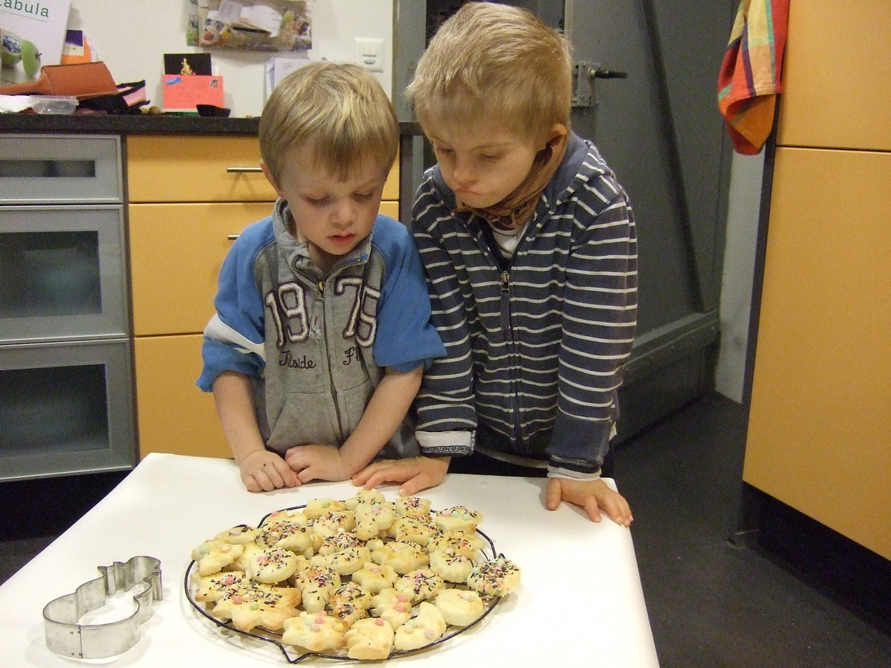 Luc and Cai inspect their latest batch of christmas biscuits