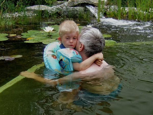 Sunday 10th July 2011 - Cai is clinging and crying, but he did very well for his first time fully in the water