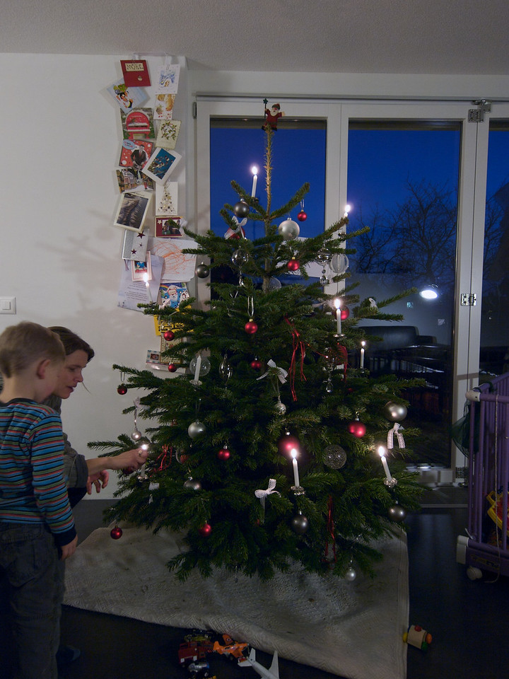 Sunday 28th Dec 2008  - Kerstin lights the candles on the tree.