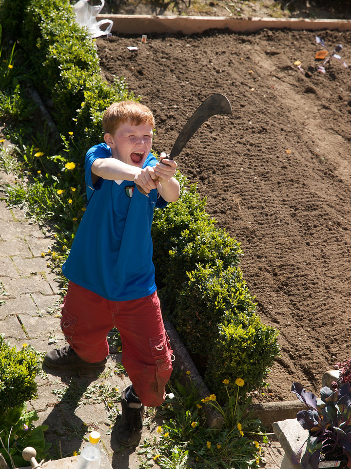 Wednesday 30th April 2008 - Oliver goes out to pick some flowers for his mother, I think the blade is a bit unnecessary though