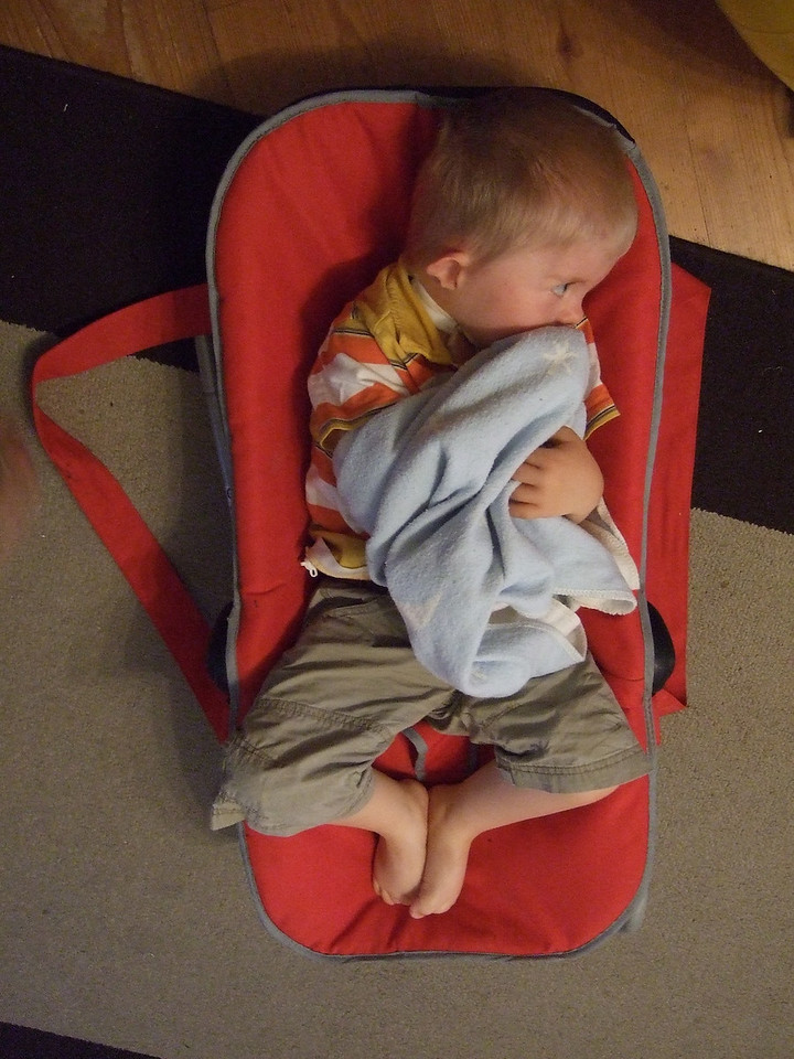 Monday 18th Aug 2008 - I guess with all the upheaval of late Cai sometimes just want to go back to being a baby like Luc whose chair he is sitting in - yes we know it used to be Cai's but he is too big for it now.
