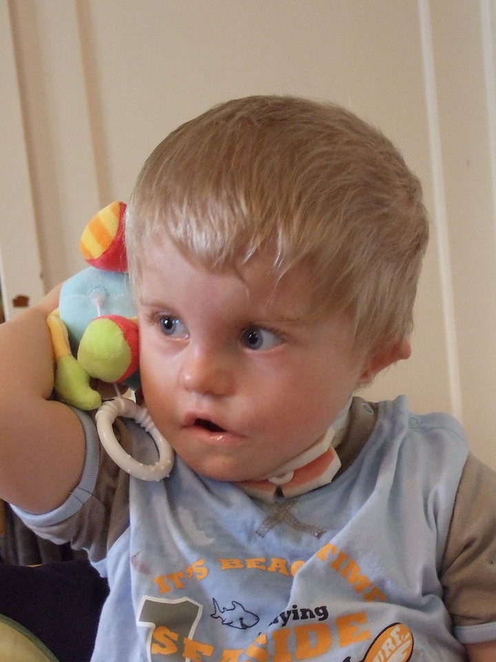 Sunday 1st June 2008 - Hello Hello! Cai here.  <br /> <br /> Cai reached across and picked up one of Luc's musical toys and held it to his ear as you can see he is not wearing his hearing aids. We have noticed that he reacts more to sounds even when not wearing his BAHA hearing aids.<br /> <br /> We are continually pleased by the way Cai improves, it keeps spirits up on this long arduous journey
