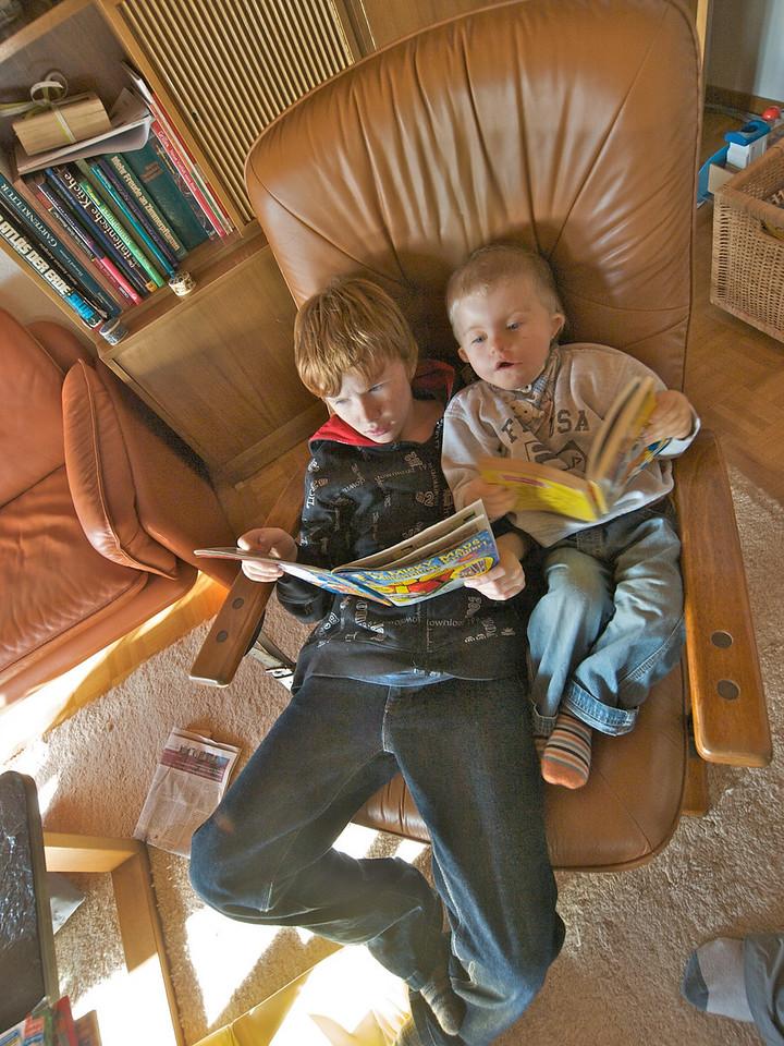 Thursday 27th Nov 2008 - Oliver shows Cai how to read.