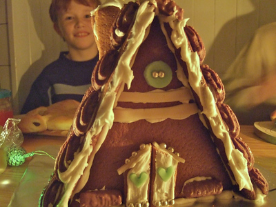 """Monday 10th Dec 2007 - Kerstin made us boys a gingerbread house, hmm looks good enough to eat.<br /> <br /> It has been a busy week, Cai has his new hearing aids, Oliver has a chistmas concert and fencing tournament and jason gets a chocolate mouth followed by a milk mouth.<br /> <br /> Cai is reacting well to his new BAHA hearing aid, this type works by sending a signal direct to teh skull which bypasses the outer ear, we have all tried it and it is amazing to listen through this system, it is very tiring for Cai who now has to learn to hear, but we see him reacting to sounds and speech now when he didn't before.<br /> <br /> Oliver looked very smart for his christmas concert and his team came third in the fencing tournament. Jason is doing okay at school but needs to concentrate. Michael is also having exams at the moment so good luck to him.<br /> <br /> We also get a visit from a family who have a five month old """"Charger """" just about to come home for the first time.<br /> <br /> Birthday wishes to IanIan sabina dibbs"""