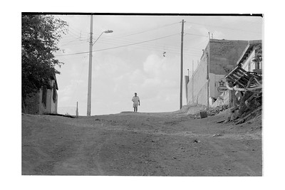 Man at Top of Hill In Middle of the Street