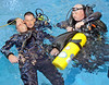 From left, search and rescue diver David Ricks, Lt. Tony Thuman and Jeffrey Burdette perform a diver down CPR rescue exercise.