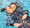 From left, search and rescue diver Officer David Ricks and diver Lt. Tony Thuman go through a  diver down CPR water rescue training exercise.