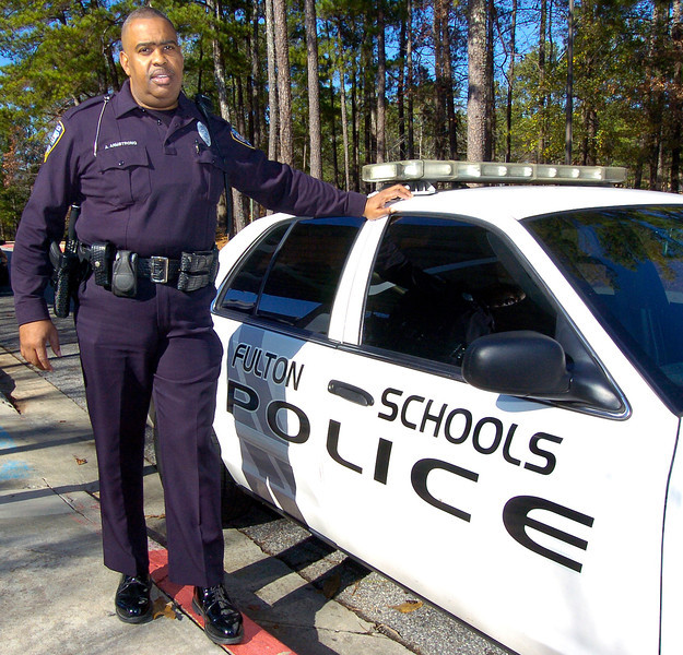 CLAY-SFUL 12.14.11 ANCHOR 2<br />  Fulton County Resource Officer Arthur Armstrong outside Mcnair Middle School.<br /> PHOTO BY JOE LIVINGSTON/STAFF
