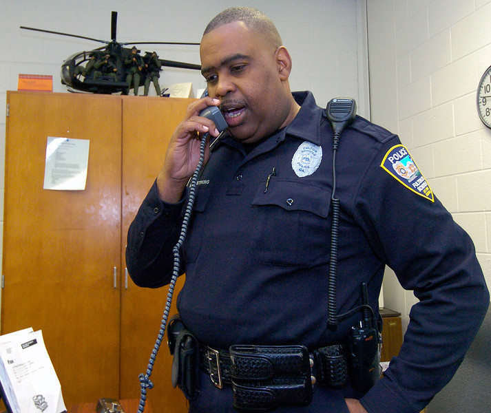 CLAY-SFUL 12.14.11 ANCHOR 7<br />  Fulton County Resource Officer Arthur Armstrong  talks over school security procedures at Mcnair Middle School.<br /> PHOTO BY JOE LIVINGSTON/STAFF