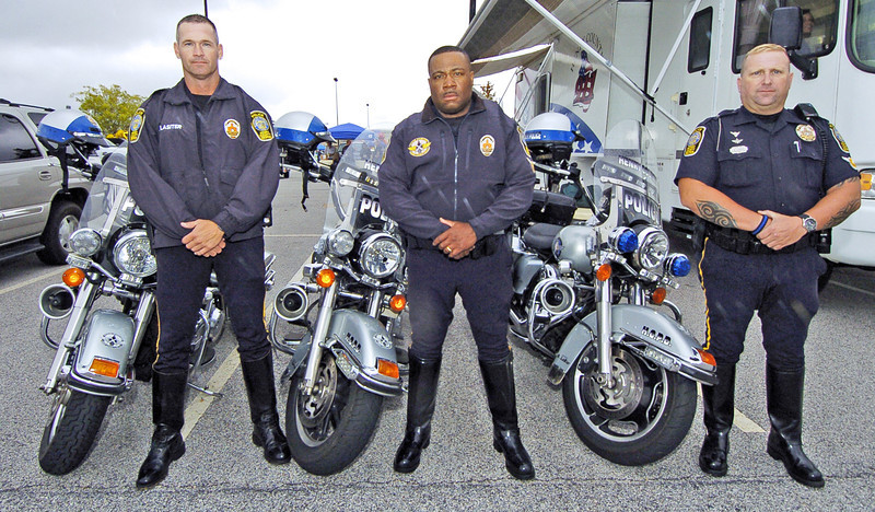 Henry County Police Motorcycle Unit Officers from left,  Henry County National Night Out <br /> PHOTO BY JOE LIVINGSTON/STAFF