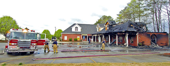Douglas Firefighters from Station 11 quickly extinguished a blaze that destroyed most of the Autum Village strip mall located at the corner of Hwy. 92 and Brickleberry Way in Douglasville.