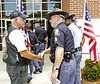 Patriot Guard Rider Jim Totten from Zebuklon greets Officer Pete Mcaleb of the Department of Public Safety as he enters the church service for slain Clayton County Police Officer Rick Daly.