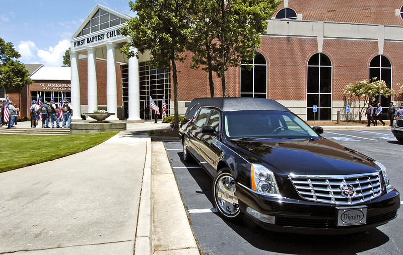 Hearse sits awaiting the casket containing slain Clayton County Police Officer Rick Daly.