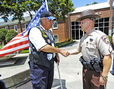 From left, Patriiot Guard Rider and Acworth Alderman Bob Weatherford greets Paulding County Sherrifs Dept. PIO Brandon Gurley as he enters the funeral for slain Clayton County Police Officer Rick Daly.