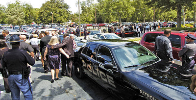 Hundreds of officers leave following the funeral of slain Clayton County Police Officer Rick Daly.