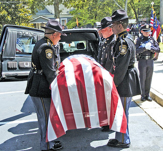 Honor Guard placing the casket in the hearse folowing the funeral of slain Clayton County Police Officer Rick Daly.