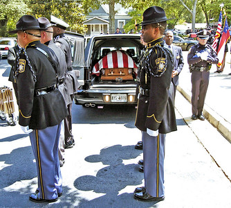 Honor Guard at attention after placing the casket in the hearse folowing the funeral of slain Clayton County Police Officer Rick Daly.