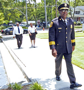 Dekalb County Asst. Police Chief Dale Holmes attends the funeral for slain Clayton County Police Officer Rick Daly.
