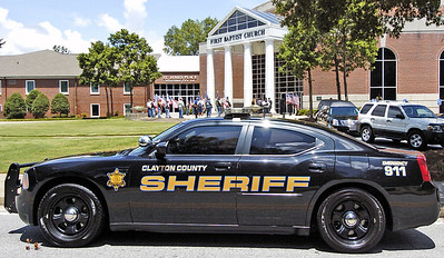 Clayton patrol car waits to escort the hearse carrying slain Clayton County Police Officer Rick Daly.