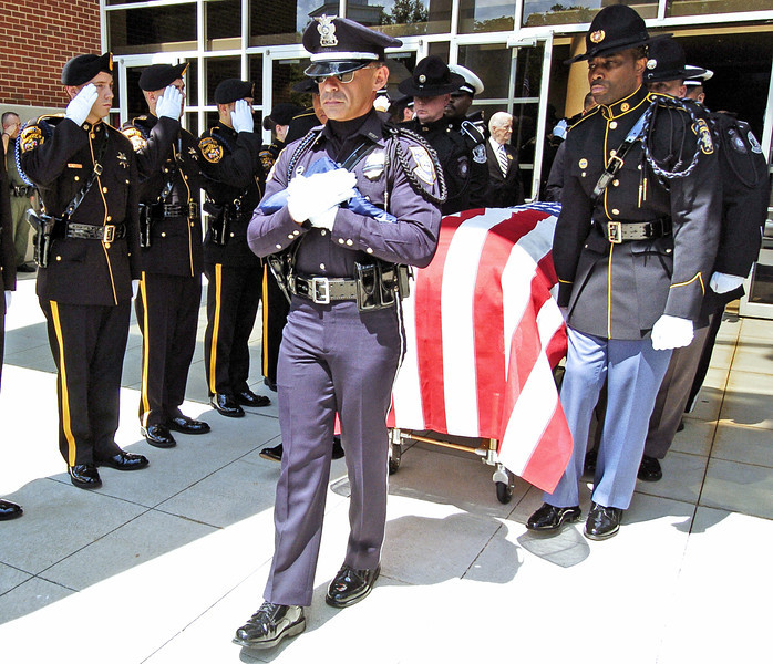 Honor Guard carrying the casket of slain Clayton County Police Officer Rick Daly.