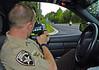 Paulding County Sheriff's HEAT Unit Deputy Jerrod Wall runs radar looking for motorcycle violations.