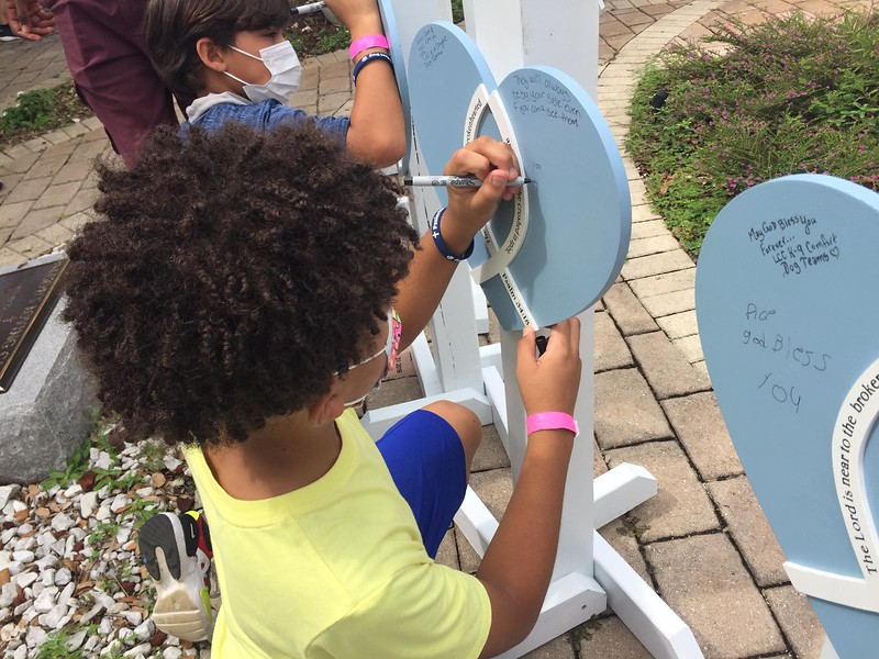 Children from Holy Cross Lutheran Christian School and Church signing the Hearts of Mercy and Compassion for those who died in the horrific collapse