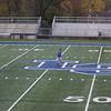 Corey Mesmer walks the field on senior night.
