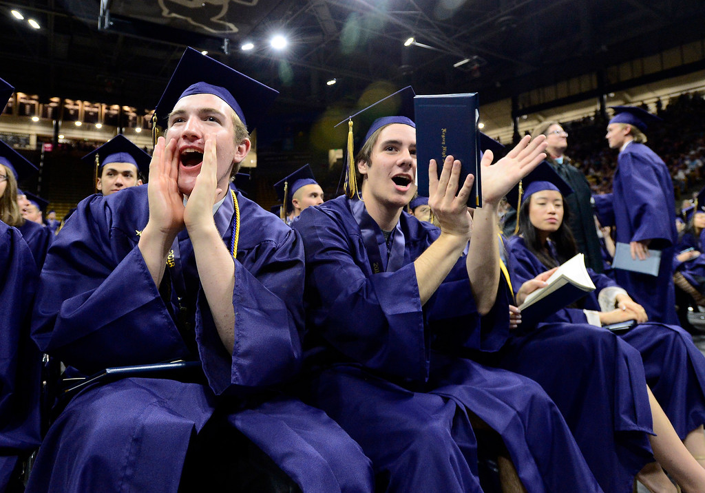. Jacob Maki, left, and Booker Makowski cheer for their fellow students at the Legacy High School Graduation at the Coors Events Center on the CU Boulder Campus Wednesday evening. For more photos go to dailycamera.com Paul Aiken Staff Photographer May 16, 2018
