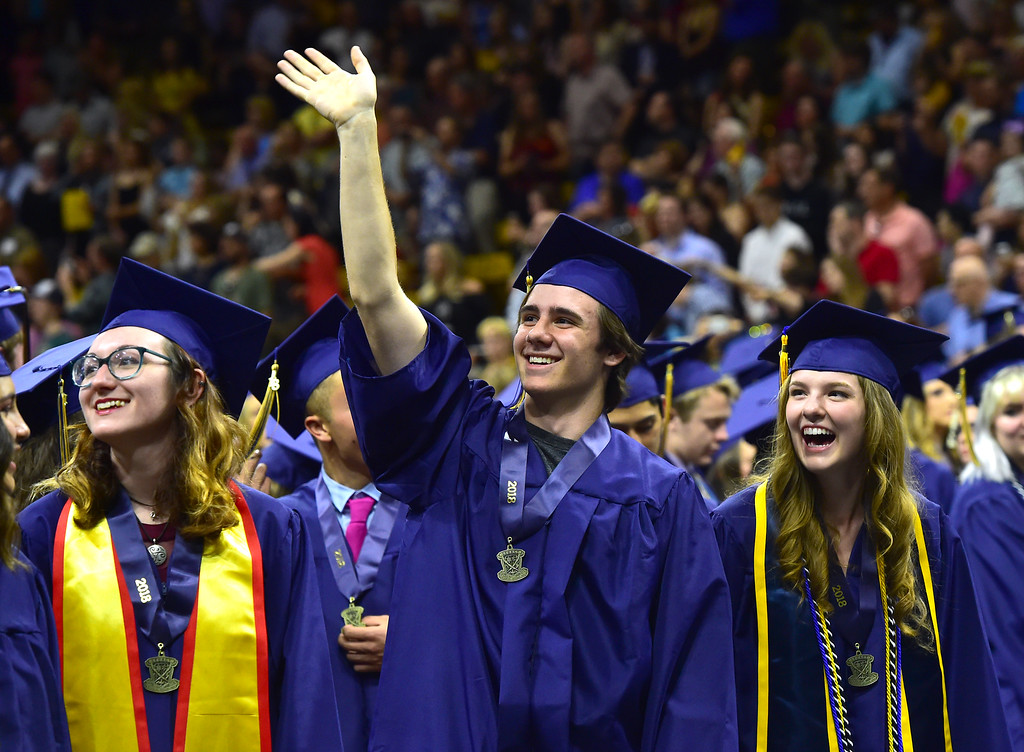 . Liliana Maisano, left, Booker Makowski and Tegan Malecha react to the cheers from the crowd at the Legacy High School Graduation at the Coors Events Center on the CU Boulder Campus Wednesday evening. For more photos go to dailycamera.com Paul Aiken Staff Photographer May 16, 2018