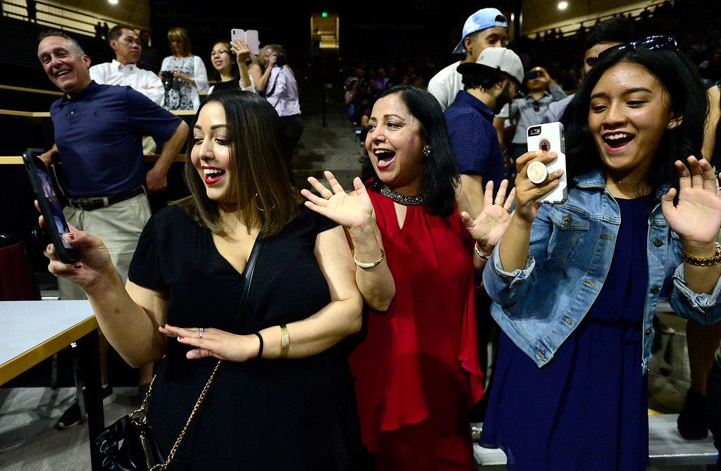 . From left to right, Sweta Adhikari Regmi, Usha Adhikari and Samridhi Shrestha cheer on graduate Sashi Sharma as she passes by them at the Legacy High School Graduation at the Coors Events Center on the CU Boulder Campus Wednesday evening. For more photos go to dailycamera.com Paul Aiken Staff Photographer May 16, 2018