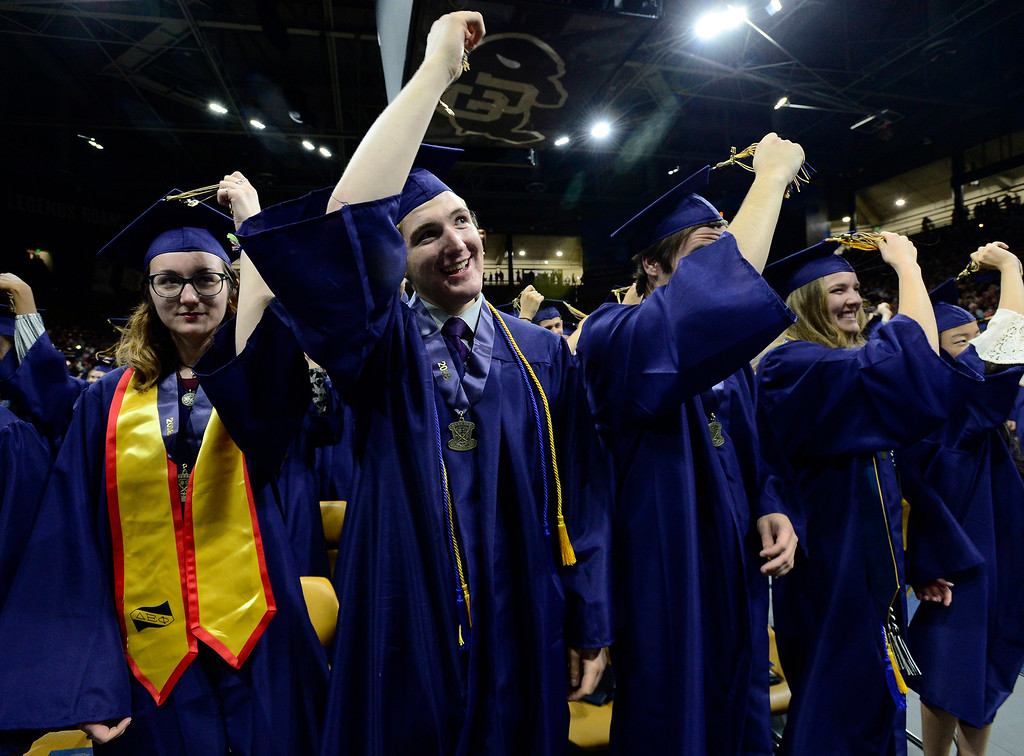 . Liliana Maisano and Jacob Maki, change their tassels at the end of the Legacy High School Graduation at the Coors Events Center on the CU Boulder Campus Wednesday evening. For more photos go to dailycamera.com Paul Aiken Staff Photographer May 16, 2018