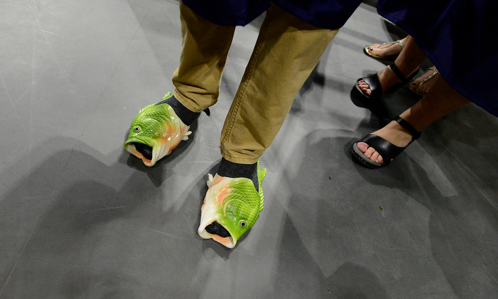 . Alex Young sports a pair of fish shoes at the  Legacy High School Graduation at the Coors Events Center on the CU Boulder Campus Wednesday evening. For more photos go to dailycamera.com Paul Aiken Staff Photographer May 16, 2018