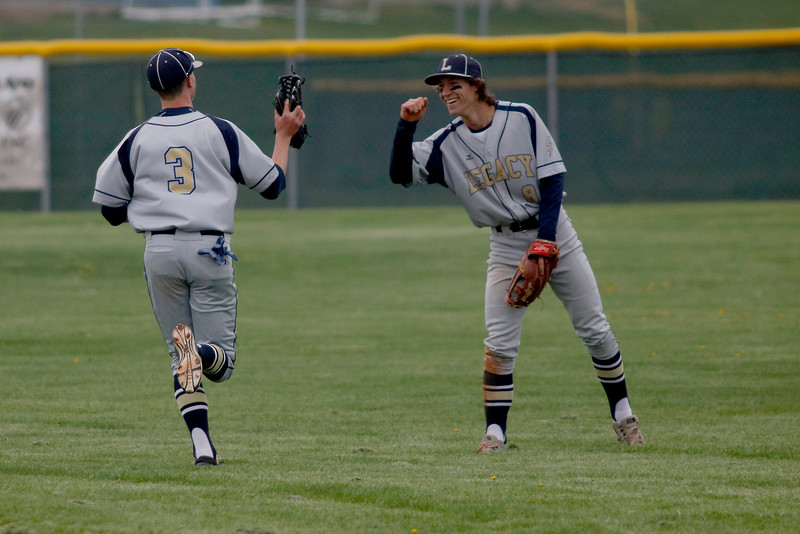 Jordan Luthi and Bradon O'Connor of Legacy celebrate a double play against Broomfield on Saturday, May 7, 2016 in Broomfield. (Photo by Trevor Davis)