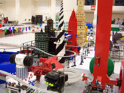 A good view of the sprial landing pad building, the red rocket shaped building (which I call the Alien Embassy) and the tan building.  All my MOC
