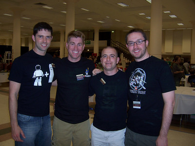 Lego Buddies!  Chris, Me, David, Jeff.  We are all wearing different black Lego shirts.