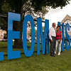 The City of Leominster has put some giant letters spelling LEOM NSTER with the I missing so you can take pictures of yourself in that space when you come to see them on the common at Monument Square in the Downtown. Mayor Dean Mazzarella poses with Damarielys Toro, 22, from Fitchburg in the I spot on Friday morning. SENTINEL & ENTERPRISE/JOHN LOVE