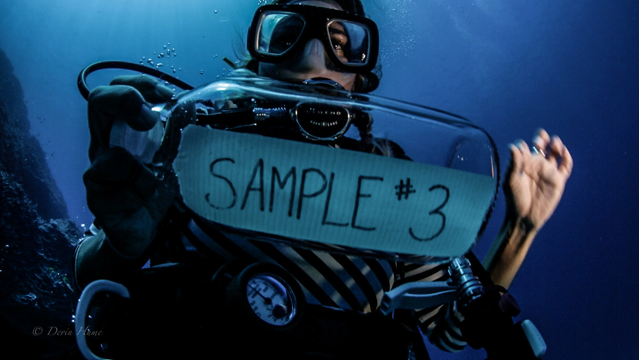 Abbey Koshak collecting underwater samples.<br /> Photo: Devin Hume<br /> thelovewaters.com