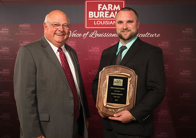 Adam Caughern of Caddo Parish wins the 2017 Young Farmers and Ranchers Discussion Meet. The award was presented by Louisiana Farm Bureau President Ronnie Anderson.