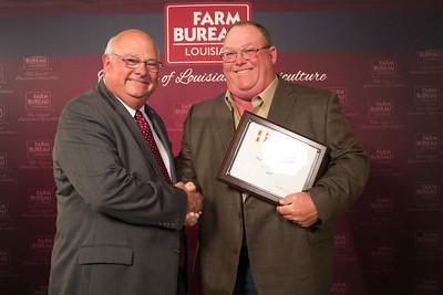Bossier Farm Bureau Parish President Loyd Dodson accepts the Three Gold Star Award from Louisiana Farm Bureau President Ronnie Anderson.