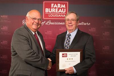 Allen Farm Bureau Parish President Thomas Mayes accepts the Three Gold Star Award from Louisiana Farm Bureau President Ronnie Anderson.