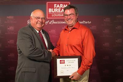 Beauregard Farm Bureau Parish President David Smith accepts the Three Gold Star Award from Louisiana Farm Bureau President Ronnie Anderson.